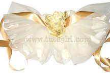 Petal Filled tutus / Flower Tutus : Flower Petal Tutus : Filled Tutus : Birthday Party Tutus  Flower petals floating in layers of soft tulle are absolutely exquisite! They are ideal for weddings, portraits, birthday parties or as a princess dress up accessory! Tutu Girl tutus have several layers and are made with yards and yards of the finest tulle, which is never scratchy. Only the best for our princesses!