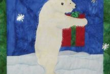 Polar Present / Polar Present - Original art work by Will Bullas. Quilt by Nan Baker of Purrfect Spots featured as a BOM in The Quilt Pattern Magazine - Feb/Nov 2013 www.quiltpatternm... Polar bear with a Christmas present.
