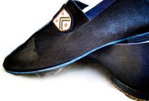 Von Trapp / Hair on black cowhide with vintage embroidered patches and a blue leather sole.