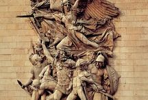 Escultura en relieve / Figuras que destacan sobre una superficie.