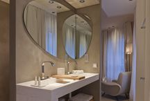 Salles de bains en béton ciré / Dans une salle de bains, le béton ciré permet de réaliser des vasques, douches à l'italienne, sols, murs... Il peut s'appliquer directement sur un ancien carrelage, sans dépose.