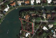FOR SALE ~ 4455 Island Road / PRIME DEVELOPMENT OPPORTUNITY ON THE ISLAND IN BAY POINT! Enjoy Sunsets over Sabal Lake with Wide Open West Exposure. Protected Harbor for Boaters with no Bridges to Biscayne Bay. 207 feet of WATERFRONT on 36,180 sf HIGHLY sought after LOT. Renovate existing family home or Build your Dream Estate. Bay Point is a Secure Gated Private Neighborhood near Design District, Midtown, Wynwood + Miami's Museum & Art's District. | OFFERED AT $7,995,000