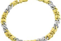Mens Gold Bracelets / Mens Gold Bracelets are put on as a fashion statement by some men to reflect their style.  Some guys wear it as a status symbol to mirror their affluence while still others wear it to emphasize their masculinity.