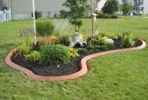 Corner flowerbed with flagpole ideas