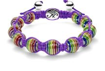 Charmballas / The Charmballa bracelets are hand-crafted from 10mm rhodium plated beads and are brilliantly detailed with stunning enamel and semiprecious stone beads in an expansive variety of colors and intricate designs. They are hand-strung on an adjustable nylon cord, and each bracelet holds a striking rhodium plated branded logo charm.