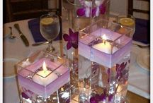 Glass centerpieces with floating candles / by Pamela