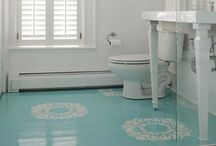 "Floor Decor / Floors need ""clothing!""  No need to cover with carpet.  Paint or stain or even use decorative area rugs."