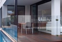 Latitude 37: Beddoe Avenue, Brighton East VIC / Built on a narrow 12.3m lot in leafy Brighton East, 14 Beddoe St is a striking additional to the streetscape. Its modern façade, with cantilevered upper floor, strikes a chord of modern design. Timber cladding, tiled feature and rendered elements provide a balance of textures.  With its clean lines and contrasting colours scheme, this home will be a favourite within the Latitude 37 folio of homes.