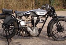 Classic motor racers / Old race aces and their bikes.