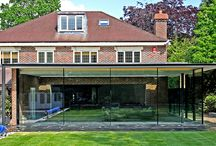 Project: Totteridge Lane / a contemporary glazed extension with floor to ceiling sliding glass doors on two sides and a structural glass rooflight within the flat roof.