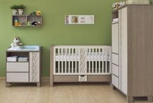 """Faktum Holly /  Holly, with its """"rolled"""" paintwork and asymmetrical cabinets accompanied by the individual baby's cot found its way to the hearts of parents."""