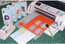 CRICUT & Other Die Cutters / Cricut Die Cutter Machine for use in crafts, such as scrapbooking, cardmaking, sewing, and quilting. Die cuts can be made as a template, or fabric designs cut for appliquing to quilts and other forms of art. / by Linda Jordan