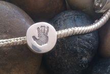 Handprint jewellery to fit Pandora / A collection of hand, foot and fingerprint jewellery to fit the popular Pandora and similar charm bracelets.