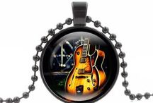 Guitar jewelry / Some great looking guitar designed jewelry for both men and women.