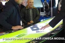ISE 2016: Interactive Signage XXXL / ISE 2016: A three meter long s-shaped counter with a seamless touchscreen exhibited the possibilities of special formats and sizes in combination with the modular multitouch system OMEGA. Its unlimited touch and object-recognition gained a lot of attention at the eyefactive booth. Also the circular multitouch table AURORA with its ability to recognize glasses gained a lot of praise among visitors.