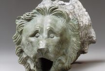 Bronze handles and lions