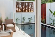 Poolside - Laser Cut Metal Art / Looking for inspiration by the pool? Create an outdoor oasis with laser cut metal art by the pool. The lighting pieces are particularly beautiful and create a warm atmosphere at night.