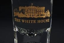 White House and Presidential Glassware / Glassware from White House Gift Shop makes beautiful decorative pieces for your home, office, or as a gift. These pieces feature beautiful gold etched images of various White House symbols, including the Presidential Seal and the White House itself. We carry a range of glassware that you can use to stock your entire bar, including wine glasses, tumblers, shot glasses, and decanters. All of our glassware is proudly made in the USA by American Glass Workers.