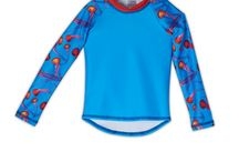 Kids Rash Guards / Our UPF 50+ rash guards for kids are packed with sun protection. They block 99.8% of harmful uva & uvb sun rays in true style. Mock neck, pieced raglan sleeve construction, elongated sleeves and functional longer tail that stays put while in movement makes the ideal choice for extended sun exposure. Made in the USA 100%.