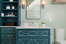 KKDL Portfolio: Marvelous in Marble / Tiled in marble throughout, this space is distinctly sophisticated with hand-hewn details and high-contrast finishes. Metallic bathroom sconces frame a free-standing vanity while shelving provides extra space for all of the necessities. Gray and white marbled tile line the bathroom floor and shower stall while a classic claw foot tub shimmers and shines in the corner of the space.