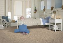 Mohawk Desert Isle Carpet / EverStrand Revive - Desert Isle is a 30 oz 100% EverStrand Revive Polyester BCF Frieze Textured cut pile carpet with Scotchgard protector. It is available in 9 colors.