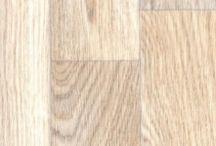Linoleum Tapiflex Living - Covor PVC fonoabsorbant pentru sufrageri si camere de zi / Colectia fonoabsorbanta de linoleum Tapiflex Living este o podea eterogena din vinil creata special pentru camere de zi si sufragerii. Este o pardoseala profesionala de trafic usor. Majoritatea modelelor acestei colectii de linoleum Tapiflex Living imita parchetul si lemnul natural, dar exista si modele cu minerale. Acest linoleum acustic fonoabsorbant este foarte usor de curatat si rezistent la pete datorita stratului intaritor din poliuretan Top Clean