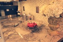 Vickie's Kitchen - by - AmeriCabinets / White Merilat kitchen cabinets, Super white quartzite countertop, Blanco sink and faucet, Miele coffee maker, and SubZero refrigerator.