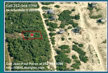 Lot for Sale on the Outer Banks NC | 2062 Sandpiper Rd / Make this the site of your beach home. This 4th row lot has just been partially cleared to get a better feel for what it offers while still leaving enough live oak trees for a little privacy from the road and still being able to enjoy panoramic views by looking over the top of them. With the right house plans you should not only be able to see the ocean to the East, but also a large area of land dedicated to the wildlife to the West. Call me, Jean-Paul Peron, at 252-564-9390.