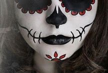 the day of the dead-dia de los muertos / In Mexico there is that celebration:The day of the dead and everyone is dressed up like a flower-skeleton that day at a carnival that is also done in Spanish.