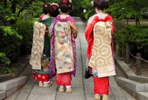 """Fashions/Kimono,Geisha / The kimono (着物?) is a Japanese traditional garment worn by men, women and children. The word """"kimono"""", which literally means a """"thing to wear"""".   Kimono are T-shaped, straight-lined robes worn so that the hem falls to the ankle, with attached collars and long, wide sleeves. Kimono are wrapped around the body with the left side over the right and secured by a sash called an obi, which is tied at the back. Kimono are generally worn with traditional footwear and split-toe socks."""