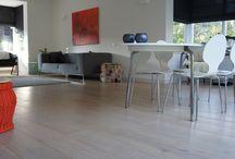 Project Boeimeer / Project in de Boeimeer te Breda. Verschillende vloeren gelegd waaronder; wit Europees eikenhout 22cm licht gerookt, laminaat en beton look antraciet 60x60cm.