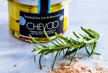 CHEVOO / Introducing CHEVOO, a one-of-a-kind artisan chèvre. Made from the highest quality goat curd, CHEVOO is hand-blended with aromatic spices, herbs, pollens, and chilis. It's then paired with an extra virgin olive oil blend that has been slowly infused with crushed botanicals. This combination of flavors in both the chèvre and infused oil makes CHEVOO truly unique. Find out more about us at http://chevoo.com/