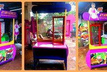 Booth Portable-Stand Makanan Praktis-Meja Pameran Unik / Aneka Macam Booth Portable Unik,antik,Fun,Colorfull,berbahan Baja Ringan dan Plat. Dijamin kuat dan tahan Lama ,Tidak seperti Booth Biasa yang ada di pasaran