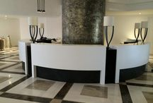 Commercial Counters / Shaker designed and fabricated DuPont™ Corian® solid surface and Ritcher Stone Veneer