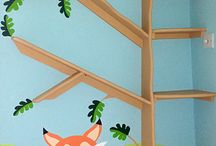 Woodland Fox Mural / This simple and charming mural was painted for a one year old baby girl. It features a Fox and other woodland animals and was painted in a very simple style with bright cheerful colours. A quirky bookshelf was created using MDF wood and shaped to look like a simple tree that was in keeping with the mural.