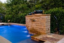 A Modern Water Feature / Here is an example of a modern water for your pool! Natural Stone Pools can make any style a reality- either modern or natural! We can do it!