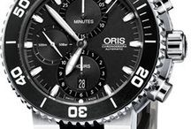 Oris Watches / Oris watches are purely mechanical and are marked out by their distinctive design as well as the red rotor, the symbol of Oris mechanicals. Oris watches are also popular, as celebrities from Formula One, diving, jazz and aviation queue up to wear and support their unique creations.  http://www.jurawatches.co.uk/collections/oris-watches