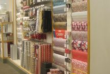 Paper Goods / We make this harder than it needs to be. Slatwall is a perfect canvas to mix and match your selection of wrapping paper, gift totes, and ribbon.