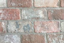 Three Design Boards using Reclaimed Veneer Belgian Red Bricks / A study of reclaimed veneer Belgian Brick reveals how many different ambiances one can create thanks to the soft reds, oak and stone colors of this amazing architectural element. Using veneer bricks as a focal wall, a back splash or fireplace surround, the eye never misses the beauty of this historic material.  https://pavehdm.com/blogs/news/reclaimed-veneer-belgian-red-brick-design-boards