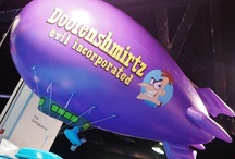 Helium Blimps / All eyes go skyward when inflatable advertising blimps are on the scene. Colorful, large and mobile, you have the ability to fly all around the crowd and even drop coupons or certificates if you choose to.