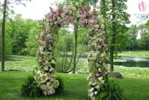 Congrats Mr. & Mrs. Johnson / A stunning outdoor wedding ceremony and reception by a pond. Floral arrangements used mix of pinks, greens and whites. All Floral Designs by McNamara Florist. All Rights Reserved.