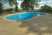 Stoneworld Swimming Pool Copings / Stoneworld are experts in creating bespoke natural stone pool copings for your swimming pool surround.  Most of our stone paving ranges are also available as pool copings