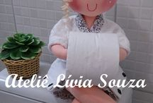 Lady holing a toilet roll