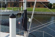 Mast raising systems