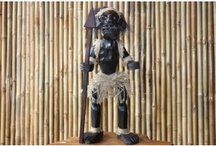 Tikis  / Primitive Tikis - Hand Carved - Hawaii Cana See them all at: www.pentizon.com - We Sell Home Decor, higher quality Tropical Accents, Hawaii Cana, Custom Tropics plus Handcrafted Works of Art Switchplates featuring palm trees, beaches, sealife, animals, birds, sports, chefs, coffee, wine & travel themes. Beachwalkers Travel Essentials, Rainwalkers Designer Umbrellas / Sunbrellas, Goldeye Leather Wallets and Unique Gifts. We ship Worldwide! - http://www.pentizon.com
