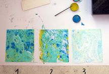 Marbling / Floating inks, oils, paints, nail polish on water or size.