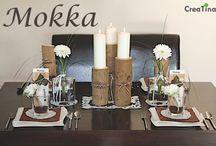 Tischdeko - Box Mokka / Verbinden Sie die Rafinesse Ihres Menü´s mit dieser Tischdekoration und zeigen Sie damit Ihre Liebe zur Natur. Die drei verschieden hohe Holzblöcke, von uns selbst sorgfältig ausgesucht und getrocknet, ergeben zusammen mit den 3 hochwertigen Safe Candle Kerzen den harmonischen Mittelpunkt Ihres festlich gedeckten Tisches. Überraschen Sie mit den zur Tischdeko-Box dazugehörigen Details Ihre Gäste. Mit der Schritt-für-Schritt Dekoanleitung und Ihrer Kreativität werden Sie Ihre Gäste verzaubern.