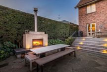 Fireplaces We Love / Inside, outside... fireplaces add a romantic air to any home.
