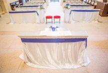 matrimonio in blu  con battesimo / Matrimonio con battesimo allestimenti preziosi in chiesa a Verona, navata chiesa con tappeto bianco, ortensie e gypsophila, banchi vestiti da morbidi tessuti, nastri blu,