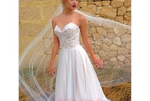 Blush gowns / A soft pearl shade peaking through traditional ivory or white shades...